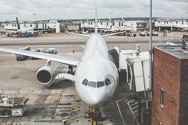 airplane-waiting-for-departure-in-the-airport-picjumbo-com.jpg